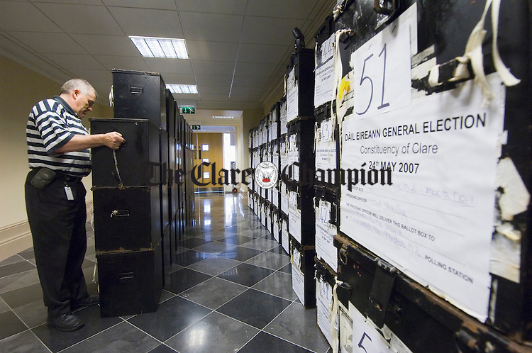 A Clare County Council employee stacking the ballot boxes at Ennis courthouse in preparation for the general election. Photograph by John Kelly.