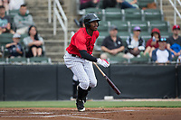 Micker Adolfo (27) of the Kannapolis Intimidators follows through on his swing against the Hickory Crawdads at Kannapolis Intimidators Stadium on May 21, 2017 in Kannapolis, North Carolina.  The Intimidators defeated the Crawdads 9-8.  (Brian Westerholt/Four Seam Images)