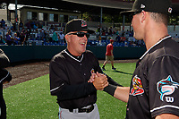Batavia Muckdogs manager Tom Lawless (10) celebrates with Nic Ready (3) after clinching the Pinckney Division Title during a NY-Penn League game against the Auburn Doubledays on September 2, 2019 at Falcon Park in Auburn, New York.  Batavia defeated Auburn 7-0 to clinch the Pinckney Division Title.  (Mike Janes/Four Seam Images)