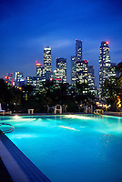 Swimming pool of the Oriental Hotel with the skyline of Singapore behind