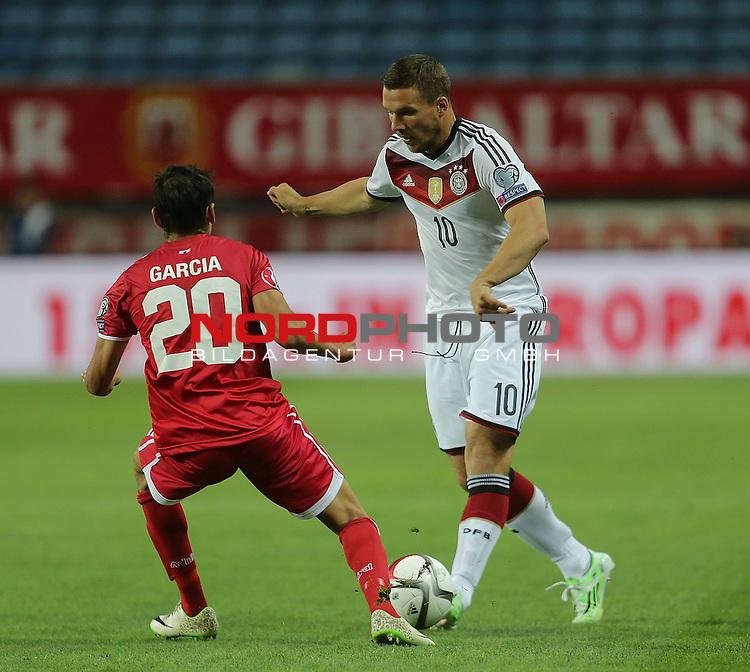 EM 2015 Qualifikationsspiel, Gibraltar vs. Deutschland<br /> Jean Carlos Priestley (Gibraltar), Lukas Podolski (Deutschland)<br /> <br /> <br /> Foto &copy; nordphoto /  Bratic