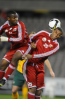 MELBOURNE, AUSTRALIA - OCTOBER 14: Hassan Madhafer and Khalifa Naufli from Oman heading the ball in a AFC Asian Cup 2011 match between Australia and Oman at Etihad Stadium on October 14, 2009 in Melbourne, Australia. Photo Sydney Low www.syd-low.com