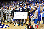 A donation check is presented to 4 Paws for Ability at the Alumni Charity Basketball Game at Rupp Arena in Lexington, Ky., on Saturday, September 15, 2012. Photo by Tessa Lighty | Staff