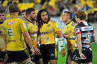 Rebels halfback Nic Stirzaker (right) tries to address Trans-Tasman relations with Callum Gibbins and Ma'a Nonu  during the Super Rugby match between the Hurricanes and Rebels at Westpac Stadium, Wellington, New Zealand on Friday, 13 March 2015. Photo: Dave Lintott / lintottphoto.co.nz