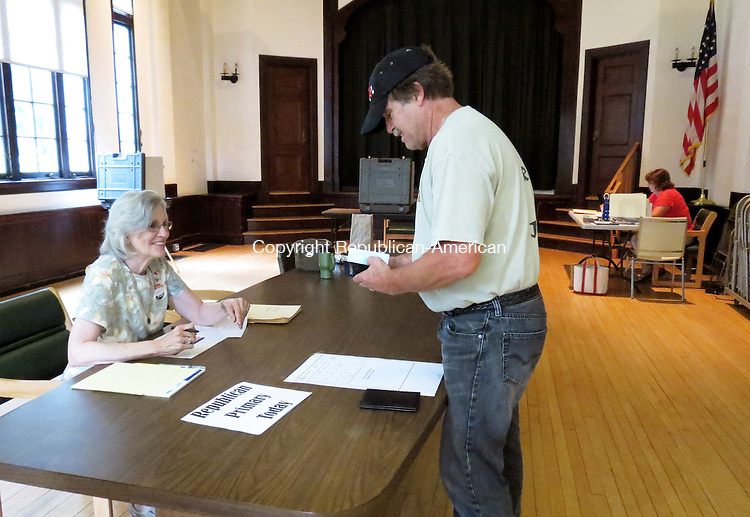 CORNWALL, CT - 13_NEW_081214RE01 - John Camp signs in with poll worker Lin LaPorta at the Cornwall Town Hall during Tuesday's Republican primary. Ruth Epstein Republican-American