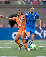 Sky Blue FC midfielder Rosana (11) tackles Boston Breakers forward/midfielder Kelly Smith (10). Sky Blue FC defeated the Boston Breakers, 2-1, at Harvard Stadium on June 13, 2010.