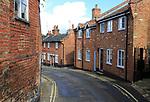 Historic red brick houses in Angel Lane, Woodbridge, Suffolk, England, UK