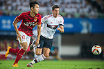 (L) Wang Sangyuan of Guangzhou Evergrande competes for the ball with (R) Robert Lewandowski of Bayern Munich  during the Bayern Munich vs Guangzhou Evergrande as part of the Bayern Munich Asian Tour 2015  at the Tianhe Sport Centre on 23 July 2015 in Guangzhou, China. Photo by Aitor Alcalde / Power Sport Images