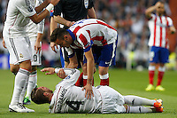 Real Madrid's Spanish defense Sergio Ramos and Atletico Madrid´s Saul