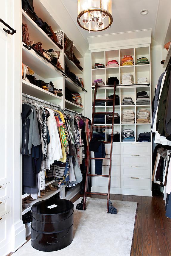 contemporary white walk in closet
