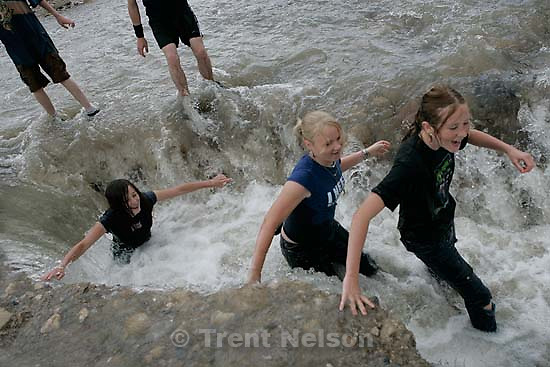 Kids playing in flood water. Flooding along 700 South in Tooele Tuesday.<br />