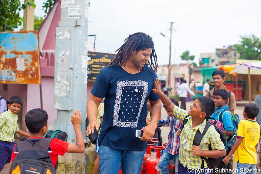 14 July 2016 - Pune - INDIA.<br /> Jamal Idris with schools kid on way to school on the streets of Balewadi village at Pune.<br /> <br /> (Subhash Sharma for the Sunday Telegraph)