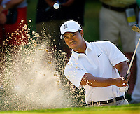 PGA golfer Tiger Woods watches a shot from a sand trap during the 2007 Wachovia Championships at Quail Hollow Country Club in Charlotte, NC.