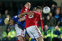 (L-R) Lyle Taylor of AFC Wimbledon, Patrick Bauer and Jason Pearce of Charlton Athletic all battle for the ball during the Sky Bet League 1 match between AFC Wimbledon and Charlton Athletic at the Cherry Red Records Stadium, Kingston, England on 10 April 2018. Photo by Carlton Myrie / PRiME Media Images.