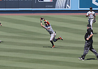25th July 2020, Los Angeles, California, USA;  San Francisco Giants outfielder Mike Yastrzemski (5) makes a catch during the game against the Los Angeles Dodgers on July 25, 2020, at Dodger Stadium in Los Angeles, CA.