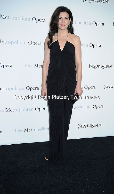 "actress Julianna Margulies in Yves Saint Laurent black dress attending The Metropolitan Opera's Gala Premiere of ""Armida"" on April 12, 2010 at The Metropolitan Opera House in New York City."