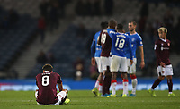 3rd November 2019; Hampden Park, Glasgow, Scotland; Scottish League Cup Football, Rangers versus Heart of Midlothian; A dejected Sean Clare of Heart of Midlothian sits on the pitch after the defeat - Editorial Use