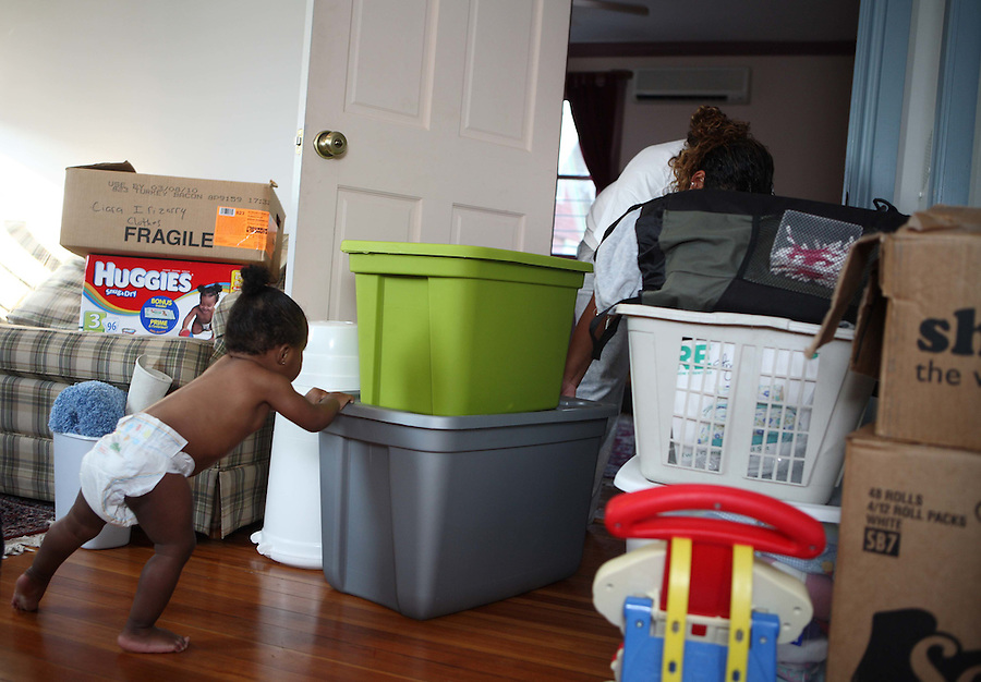 A mother moves in to the Amos House Reunification home where she will regain permanent custody of her child when she gradutes from the program
