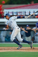 Manny Sanchez (13) of the Princeton Rays follows through on his swing against the Burlington Royals at Burlington Athletic Park on July 11, 2014 in Burlington, North Carolina.  The Rays defeated the Royals 5-3.  (Brian Westerholt/Four Seam Images)