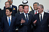David Cameron, U.K. prime minister, center, talks to Abdelmalek Sellal, Algeria's prime minister, during a family photo with Shinzo Abe, Japan's prime minister, left, at the Nuclear Security Summit in Washington, D.C., U.S., on Friday, April 1, 2016. After a spate of terrorist attacks from Europe to Africa, U.S. President Barack Obama is rallying international support during the summit for an effort to keep Islamic State and similar groups from obtaining nuclear material and other weapons of mass destruction. <br /> Credit: Andrew Harrer / Pool via CNP