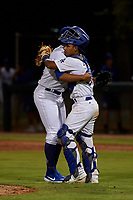 AZL Dodgers Mota relief pitcher Jeffry Abreu (59) and catcher Juan Zabala (60) celebrate a victory after an Arizona League game against the AZL Rangers at Camelback Ranch on June 18, 2019 in Glendale, Arizona. AZL Dodgers Mota defeated AZL Rangers 13-4. (Zachary Lucy/Four Seam Images)
