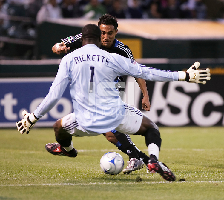 Arturo Alvarez (back) tries to score against Donovan Ricketts (1). San Jose Earthquakes tied Los Angeles Galaxy 1-1 at the McAfee Colisum in Oakland, California on April 18, 2009.