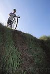 Mountain Biker considers steep drop, Mendocino California