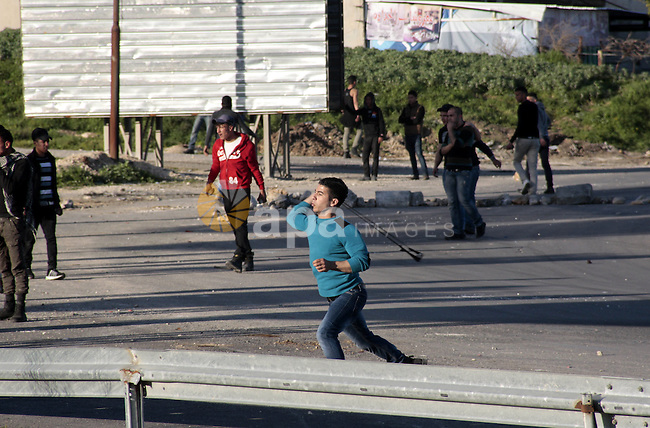 Palestinian protesters throw stones at Israeli security forces during clashes at Hawwara military checkpoint near the West Bank city of Nablus on February 26, 2013. Increased protests in the West Bank after the killing of a Palestinian Prisoner Arafat Jaradat, 30, whose death in an Israeli jail on 23 February sparked riots across the Israeli-occupied West Bank. Palestinians claim he died of torture. Israel says the initial autopsy could not determine the cause of death and further tests were needed. Photo by Nedal Eshtayah