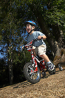 Josh riding small Raleigh bicycle  .Virginia Water , Surrey , Sept 2003..