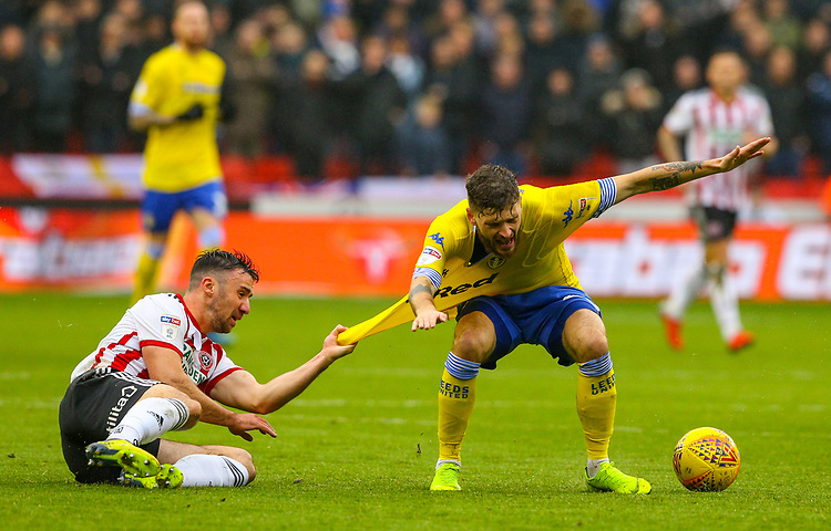 Leeds United's Mateusz Klich is fouled by Sheffield United's Enda Stevens<br /> <br /> Photographer Alex Dodd/CameraSport<br /> <br /> The EFL Sky Bet Championship - Sheffield United v Leeds United - Saturday 1st December 2018 - Bramall Lane - Sheffield<br /> <br /> World Copyright © 2018 CameraSport. All rights reserved. 43 Linden Ave. Countesthorpe. Leicester. England. LE8 5PG - Tel: +44 (0) 116 277 4147 - admin@camerasport.com - www.camerasport.com