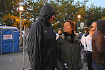 Denis Brogniart, French host of French reality television show Survivor, enters the start of the race with his wife Hortense Brogniart and fellow French runners before the Chicago Marathon in Chicago, Illinois on October 11, 2009.