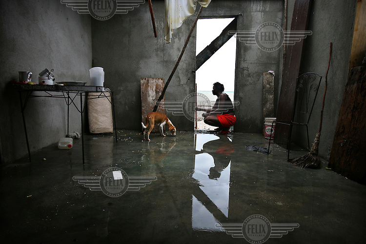 Amelta Pierre in her house that was destroyed by Hurricane Dean.