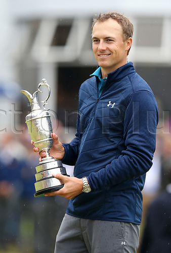 23rd July 2017, Royal Birkdale Golf Club, Southport, England; The 146th Open Golf Championship, fourth round ; Jordan Spieth (USA) smiles as he holds the claret jug trophy as Champion Golfer of the Year