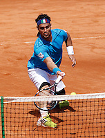 Italy's Fabio Fognini returns a shot against  Britain's Andy Murray during their Davis Cup quarter-final tennis match in Naples April 6, 2014.