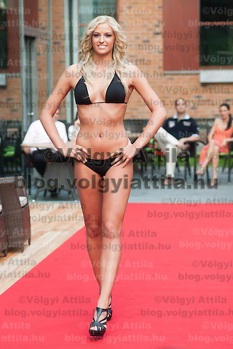Vivien Meszaros a participant of the Beauty Queen contest attends a bikini tour in Hotel Abacus, Herceghalom, Hungary on July 07, 2011. ATTILA VOLGYI