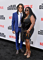 "LOS ANGELES, USA. June 04, 2019: Elgin Charles & Golden White at the premiere for ""The Black Godfather"" at Paramount Theatre.<br /> Picture: Paul Smith/Featureflash"