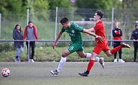 Marco Boras (Offenbach, grün) verteidigt gegen Amer Smajovic (Büttelborn) - Büttelborn 15.05.2019: SKV Büttelborn vs. Kickers Offenbach, A-Junioren, Hessenpokal Halbfinale