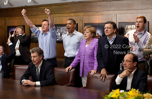 Prime Minister David Cameron of the United Kingdom, United States President Barack Obama, Chancellor Angela Merkel of Germany, José Manuel Barroso, President of the European Commission, and others watch the overtime shootout of the Chelsea vs. Bayern Munich Champions League final in the Laurel Cabin conference room during the G8 Summit at Camp David, Md., May 19, 2012. .Mandatory Credit: Pete Souza - White House via CNP