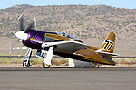 Rare Bear, piloted by John Penney, taxies prior to a heat race during the 2008 Reno Championship Air Races. Penney piloted the highly modified Grumman Bearcat during the Unlimited Gold Championship Race but did not finish due to a failure of the Pratt & Whitney R3500 engine.