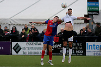 Ben Goodliffe of Dagenham in an aerial challenge with Bromley's Joe Quigley during Bromley vs Dagenham & Redbridge, Vanarama National League Football at the H2T Group Stadium on 24th November 2018