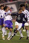 10 February 2006: Josh Wolff (16) of the U.S. is slips past Japan's Tsuneyasu Miyamoto (5) and Yuji Nakazawa (behind, right) of Japan. The United States Men's National Team led Japan 3-0 early in the second half at the Pac Bell Park in San Francisco, California in an International Friendly soccer match.