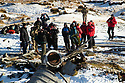 09/11/19<br /> <br /> Approximately 30 hikers converge on the snowy crash site to pay their respects.<br /> <br /> Surrounded by fresh overnight snow, hikers gather, in one of the remotest areas of the Derbyshire Peak District, for a two minute silence and to lay wreaths and crosses on the wreckage of an American RB29 bomber, known  as 'Over-Exposed' which crashed on Bleaklow Moor near Higher Shelf Stones, killing all thirteen crew in November 1948. Piles of twisted metal have been piled up to form a makeshift memorial that lies next to whole engines, pieces of fuselage, wings, wheels and other twisted parts of aluminium that have lain on the moors for  71 years.<br /> <br /> Today prayers were said, a harmonica player performed the Last Post and Taps (the US equivalent) and members of the Woodhead Mountain Rescue teams remembered their forbears who were first to arrive at the crash scene after the bomber descended in low cloud hitting the high peak.<br /> <br /> All Rights Reserved: F Stop Press Ltd.  <br /> +44 (0)7765 242650 www.fstoppress.com