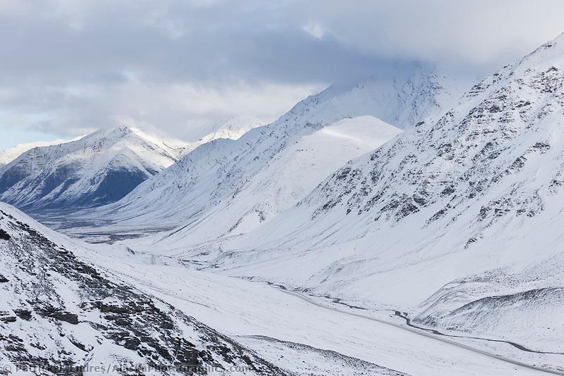 James Dalton highway passes through Atigun canyon of the Brooks range mountains in arctic, Alaska.