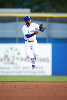 Dunedin Blue Jays shortstop Richard Urena (5) jumps in the air to field a ball during a game against the Palm Beach Cardinals on April 15, 2016 at Florida Auto Exchange Stadium in Dunedin, Florida.  Dunedin defeated Palm Beach 8-7.  (Mike Janes/Four Seam Images)
