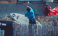Sunny Garcia (HAW) Upset with the judges and his loss during the running of the Gotcha Lacanau Pro at Lacanau Beach, in the South West of France. Circa 1995. Garcia had picked up a muffin and hurled it at the judges stand. The judges actually thought it was a rock and had ducked away from the glass front as it came towards them. Garcia was fined for his outburst. Photo: joliphotos.com