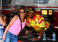 Aug. 1, 2014; Kent, WA, USA; NHRA top fuel dragster driver Antron Brown poses with a fan during qualifying for the Northwest Nationals at Pacific Raceways. Mandatory Credit: Mark J. Rebilas-