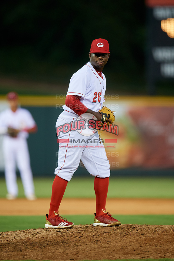 Greeneville Reds relief pitcher Perez Knowles (26) gets ready to deliver a pitch during a game against the Pulaski Yankees on July 27, 2018 at Pioneer Park in Tusculum, Tennessee.  Greeneville defeated Pulaski 3-2.  (Mike Janes/Four Seam Images)