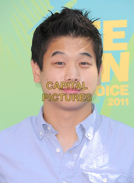 Ki Hong Lee.2011 Teen Choice Awards - Arrivals held at Gibson Amphitheatre, Universal City, California, USA..August 7th, 2011.headshot portrait blue. .CAP/RKE/DVS.©DVS/RockinExposures/Capital Pictures.