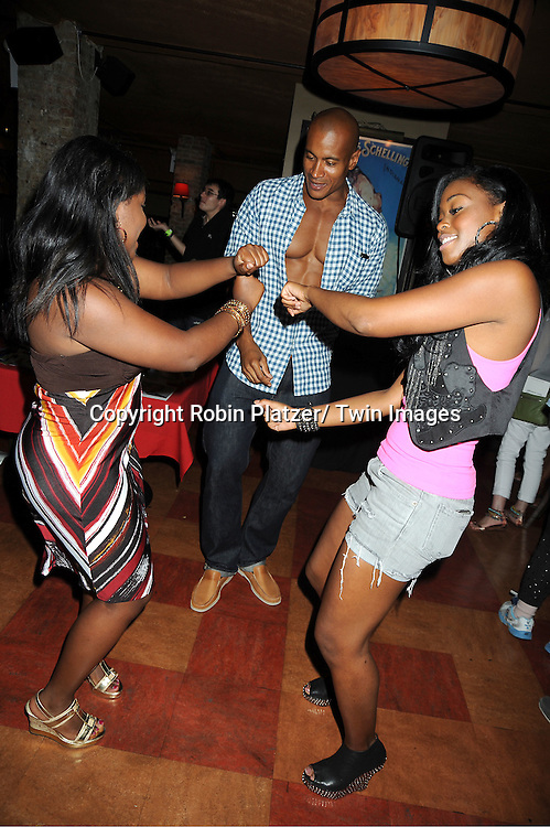 Shenell Edmonds, Max Tapper and Nafessa Williams dancing at the 5th Annual Sean Ringgold Fan Club Party on August 12, 2011 at HB Burger's Sunken Bar in New York City.