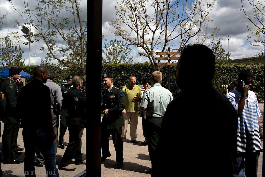 Pastor Rick Warren greets members of the US military participating in Sunday afternoon services<br />